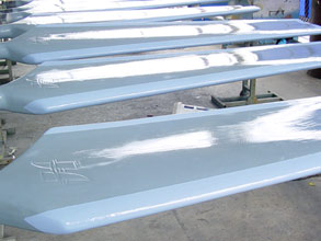 Cooling tower fan blades resurfaced and coated with corrosion resistant Belzona 1321
