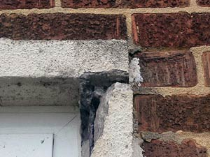 Severely spalled lintel corner