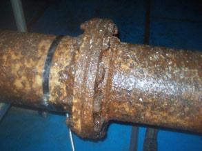 Corroded gas pipes at a food production plant with constant surface condensate