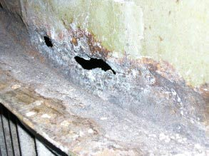 Severe corrosion resulting in through wall defects
