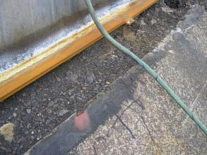 Tank base seal failure, allowing water ingress
