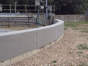 Entire tank wall repaired using Belzona 4000 Series products. Belzona 2000 Series products used to create expansion joints