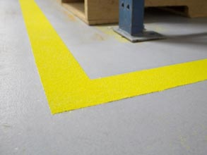 Safety Marking with Belzona 5231 (base coat), OSHA safety yellow aggregate, Belzona 5233 Clear (as a top coat)