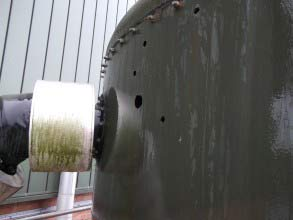 Through-wall defects on sludge buffer tank